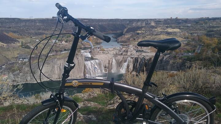 K&J Trucking foldable bike in front of falls - Rodney Rich